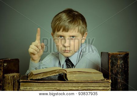 The Boy reading a vintage book