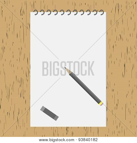 Pencil With An Album On The Wooden Table