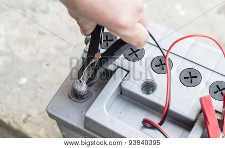 The Process Of Connecting The Charger To The The Vehicle Battery