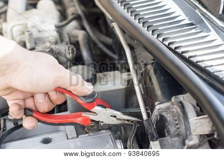 The Process Of Repairing Vehicle Using Pliers