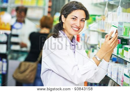 portrait of happy female pharmacist chemist woman in pharmacy drugstore