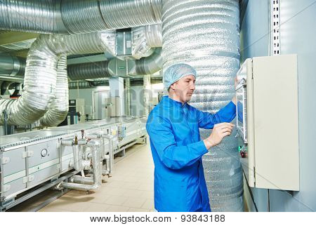 pharmaceutical man worker operating air conditioning equipment at pharmacy industry manufacture factory