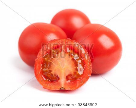 Small tomatoes isolated on white background