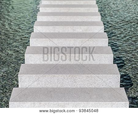 Modern concrete block pathway in water pool