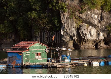 Traditional floating fisher house in Halong bay in Vietnam