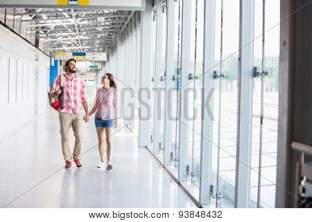 Full-length of couple walking in covered passage
