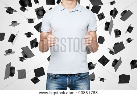 A Person With Thumbs Up. Falling Graduation Hats On The Background.