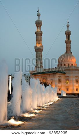 Sharjah City Mosque With Lights, Fountain, Conctruction And Modern Architecture Concept. Islam. Unat