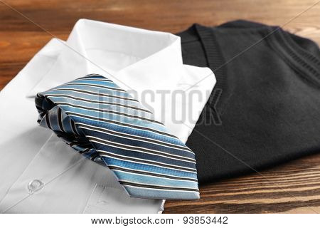 Men elegance clothes on wooden table, closeup