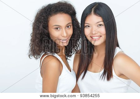 Smiling girls bonding to each other