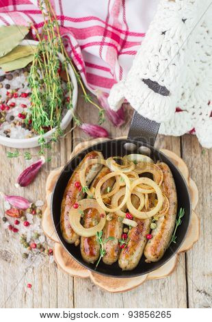 Fried sausages with spices and onions