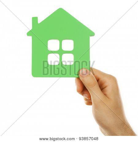 Female hand holding house isolated on white