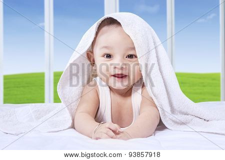 Adorable Baby With Cute Face On The Bed