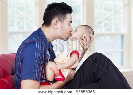 Dad Kiss His Baby At Home