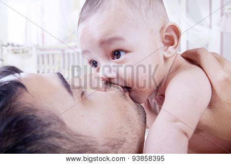 Dad Kiss His Three Months Baby