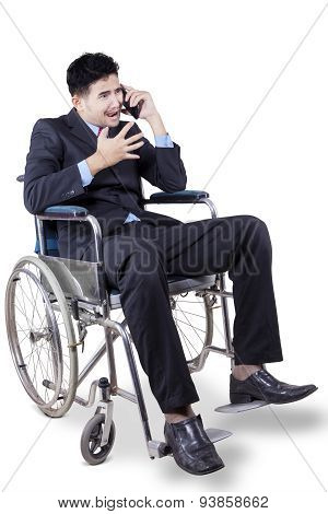 Disabled Businessperson Looks Angry On The Phone