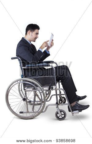 Disabled Entrepreneur Using Digital Tablet