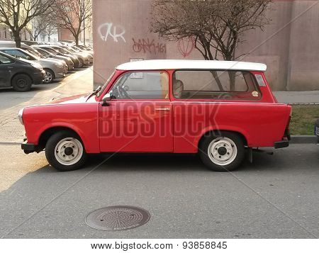 PRAGUE CZECH REPUBLIC - CIRCA MARCH 2015: Red Trabant car parked in a street of the city centre.