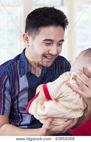 Father Smiling On His Male Infant