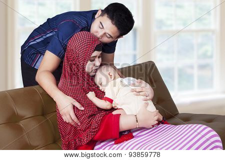 Happy Parents With Baby Boy