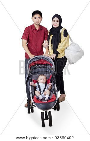 Muslim Parents With Baby On The Stroller