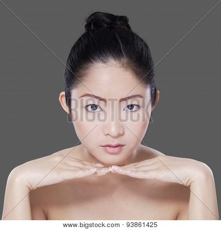 Young Chinese Woman With Beautiful Skin