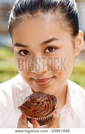 Close-up of woman with cupcake