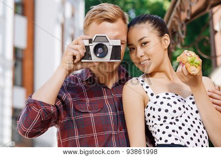 Young man taking picture near his girlfriend
