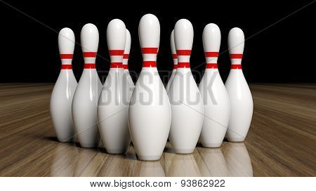 Bowling pins set on wooden floor