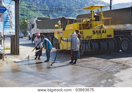 People are working on repairing the road