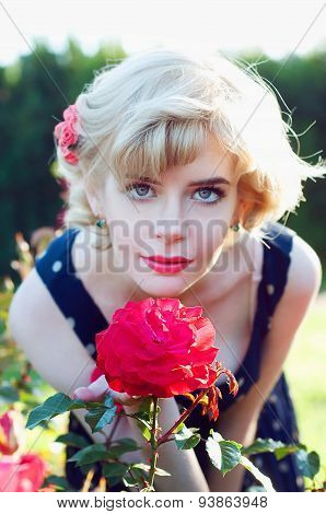Beautiful Blonde Woman Posing In The Rose Garden
