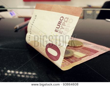Money Over Bank Counter