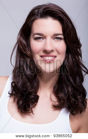 Portrait Beautiful Woman With Dark Hair Smiling In The Camera