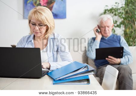 Elder Couple Working At Home