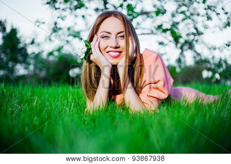 happy woman on the grass in the summer park