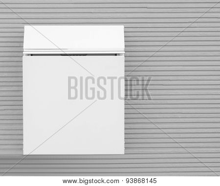 Metal post box and modern concrete wall background
