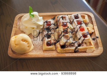 Wood Plate Of Belgian Waffles With Ice Cream And Whipped Cream