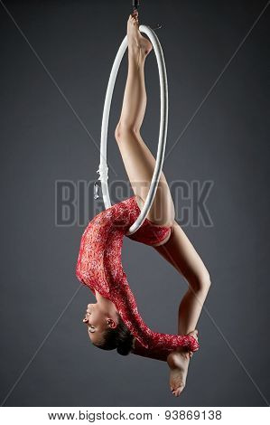 Image of flexible dance performer on aerial hoop