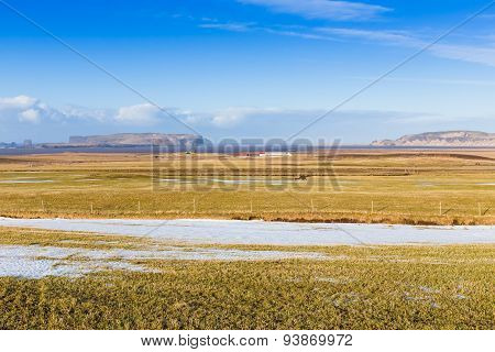 Beauty of glass field during winter with clear blue sky