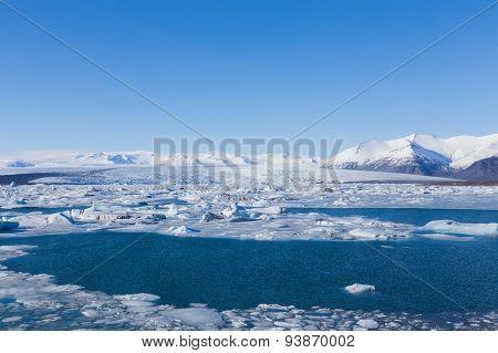 Floating ice in Jokulsarlon lagoon of icebergs in Iceland