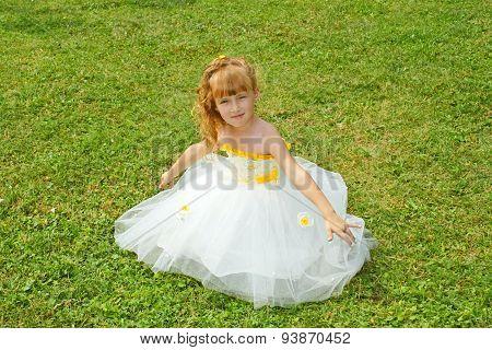 Girl In A Festive Dress On A Lawn