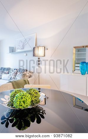 Fragment of a modern dining room table in a luxury apartment. Interior design.