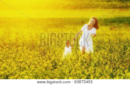 Happy Family, Mother And Child L Little Daughter Running  On Meadow With Yellow Flowers