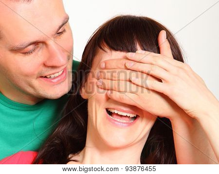 Man Covering Eyes Of Woman For Surprise