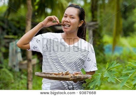 Woman Eating Fried Insects
