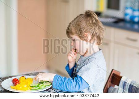 Kid Boy Eating Healthy Food In Kindergarten Or At Home