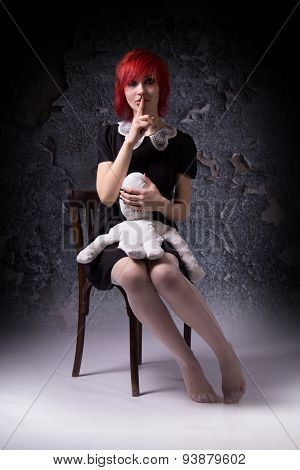 Mystical Red-haired Girl And Doll On A Chair