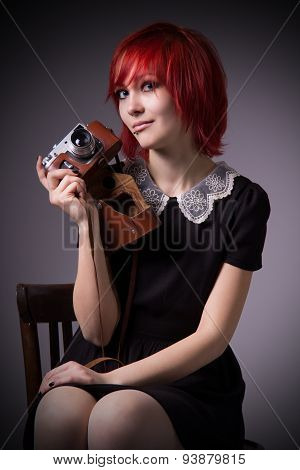 Girl With Vintage Camera On A Chair