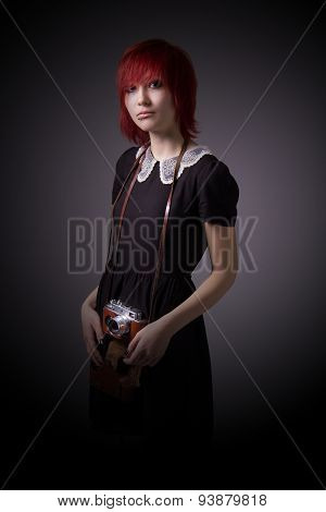 Redhead Girl With Vintage Camera