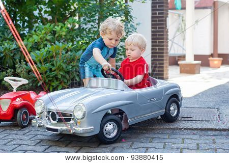 Two Little Brothers Toddlers Playing With Cars